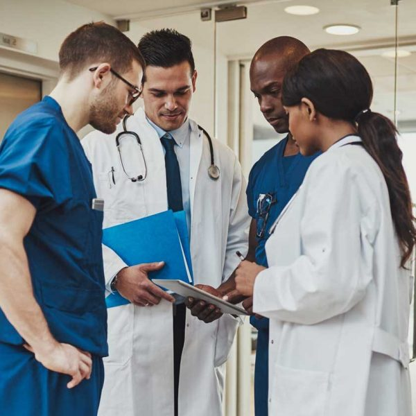 diverse-medical-team-consulting-on-a-patient-T3B9PKW.jpg